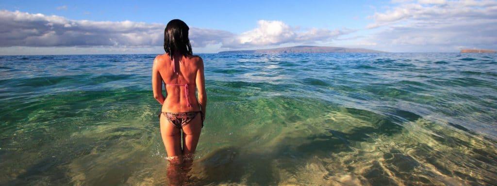 woman-standing-in-ocean-maui,-hawaii